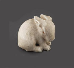 Netsuke modeled as a hare with amber eyes