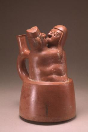 Stirrup cup: kissing couple