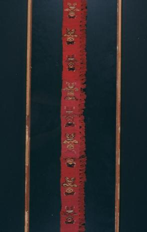 Textile Fragment with fringe:  Band with Line of Figures