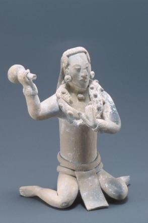 Kneeling figure of a captive, performing