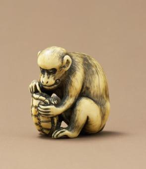 Netsuke modeled as a monkey holding a turtle