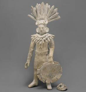 Warrior figure with mask and shield