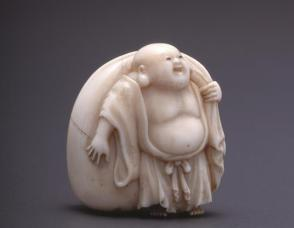 Nestuke modelled as Hotei (God of Happiness) with Treasure Bag