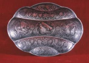 Silver repousse bowl, lobed