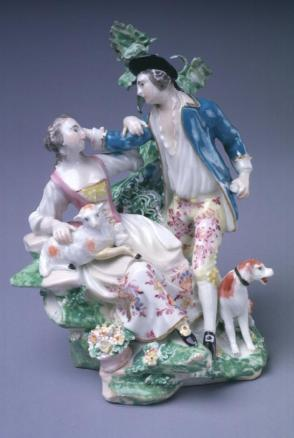 Man with dog and woman with lamb